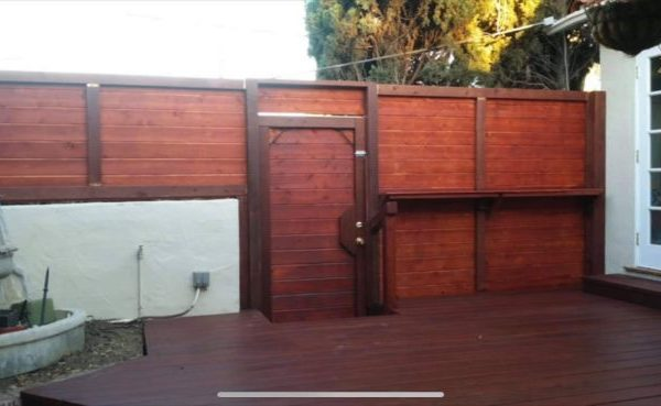 stained wood fence with door