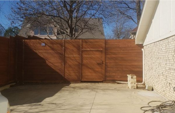 modern looking backyard fence with gate