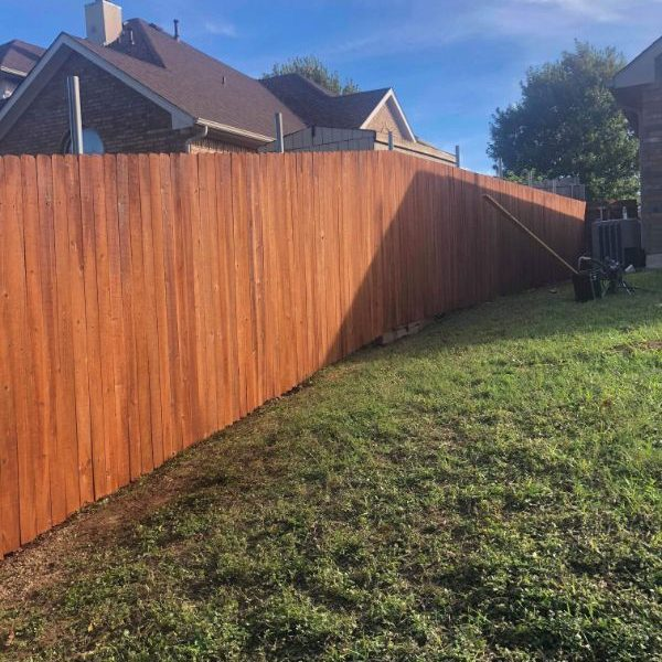brand new stained wood fence