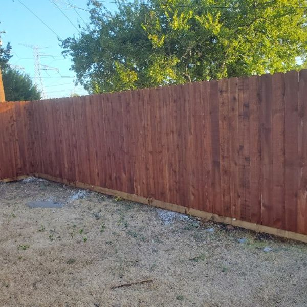 brand new wooden stained fence