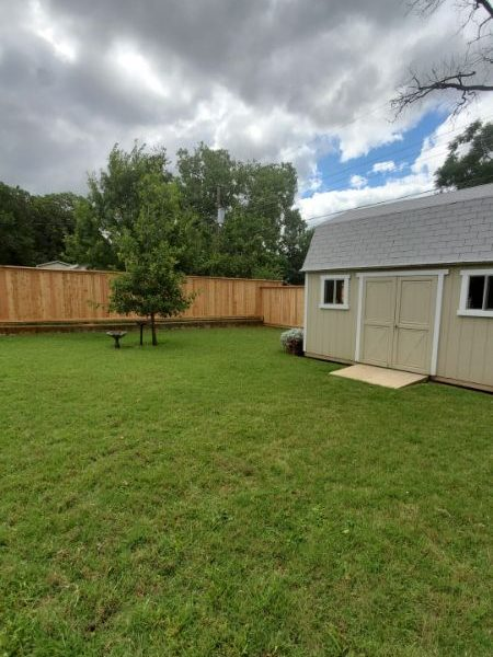 backyard with fence and shed