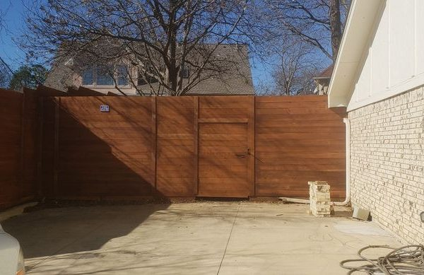 new wooden fence connected to house
