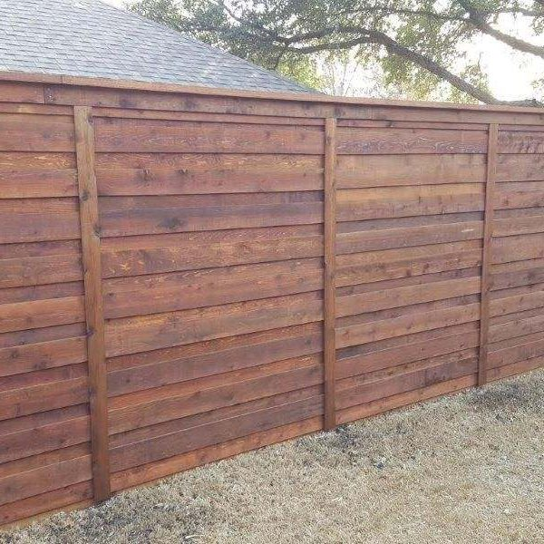 stained new privacy fence