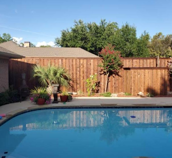 Wooden board on board residential fencing and pool