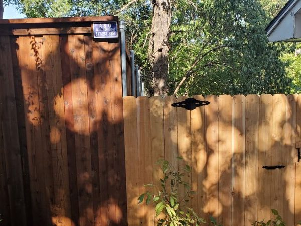 two wooden residential fences