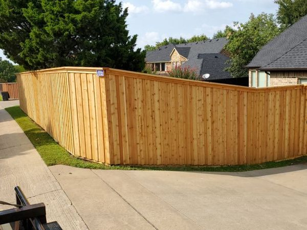 Wooden residential fencing with a custom gate