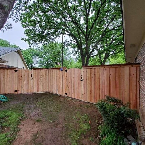 Wooden residential fencing with a gate