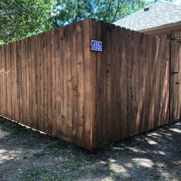 privacy fence with gate to backyard